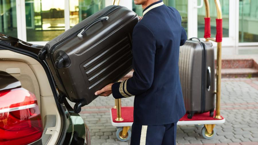 tipping in europe bellboy taking baggage