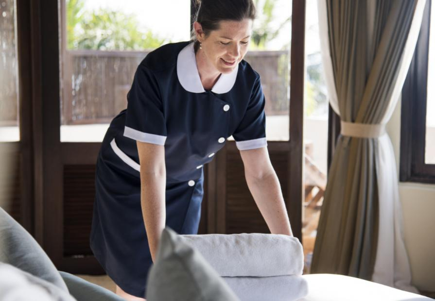 Tipping in Europe housekeeper cleaning a hotel room