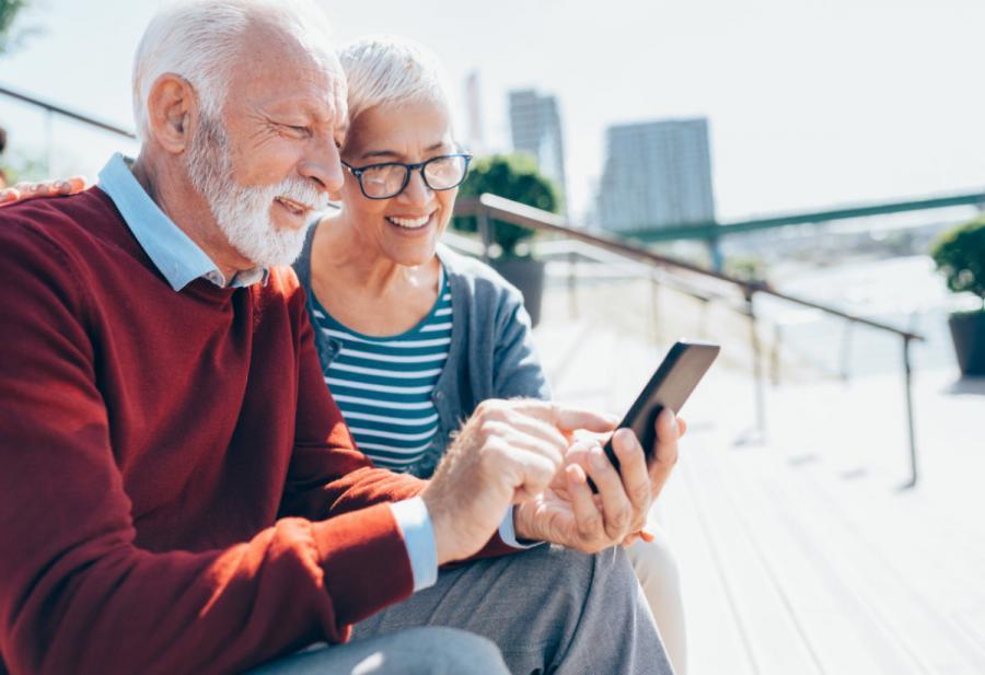 international data sim card senior couple using phone