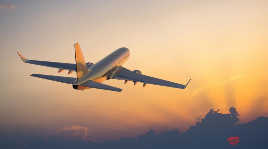 jet lag symptoms airplane flying west towards sunset