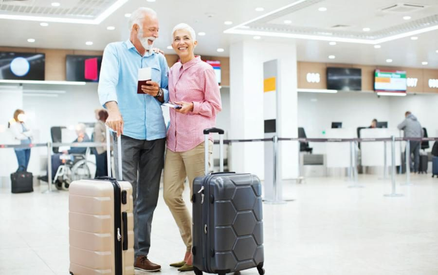 over 50 travel insurance couple at airport