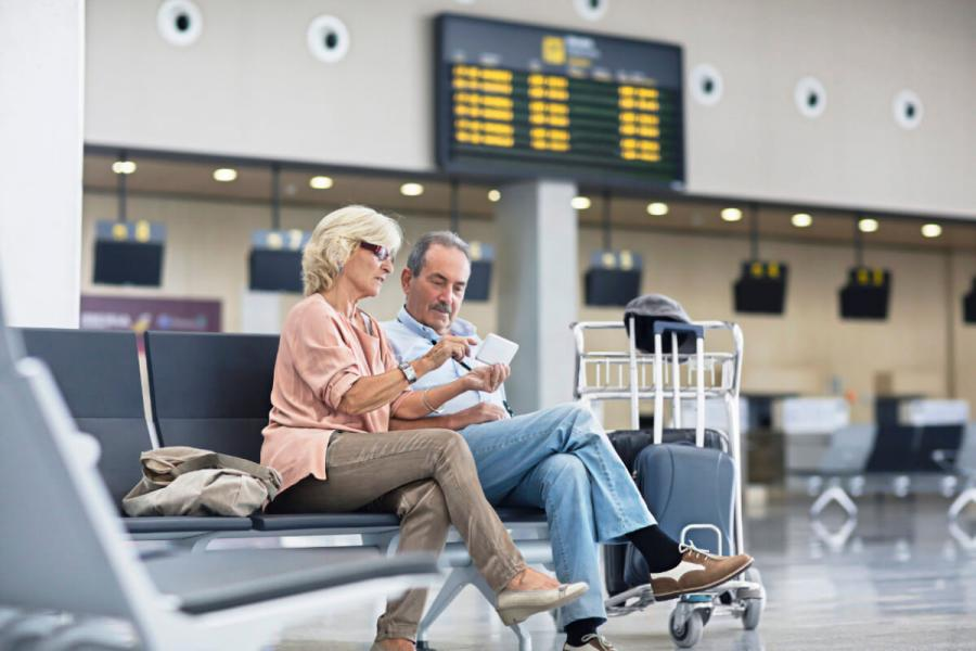 over 50s travel insurance senior couple airport