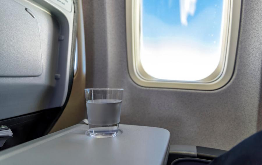 long haul flight tips water on plane