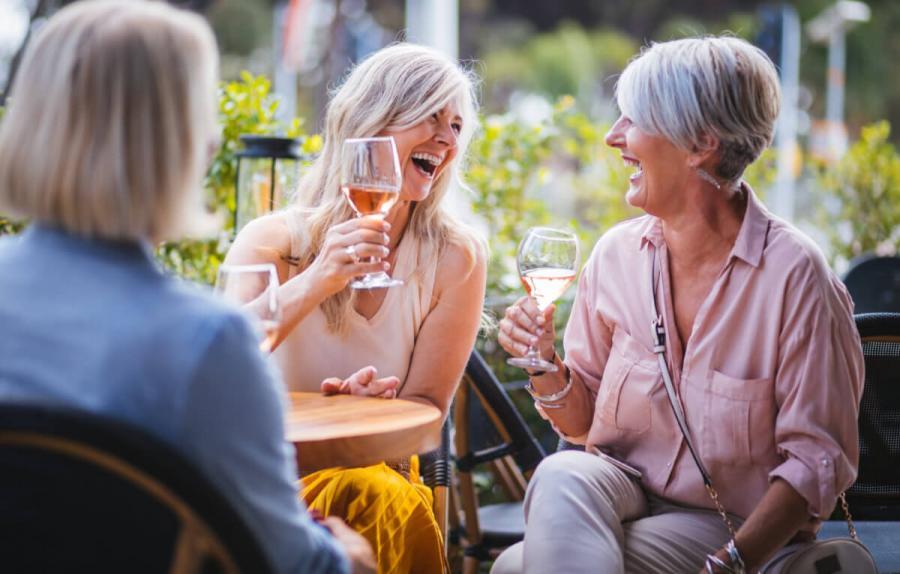 wine tasting tours women enjoying wine at vinyard
