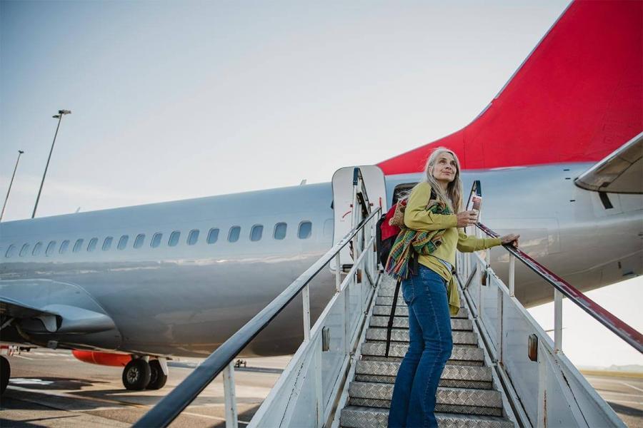 female solo tarveller boarding a plane