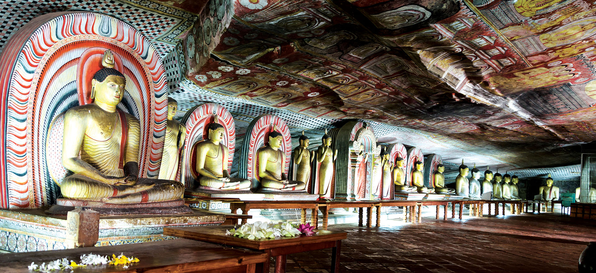 Gold Buddhas in the Dambulla Cave Temple | Tours to Sri Lanka