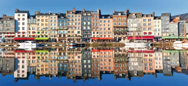 Colourful row of houses reflected in water, Honfleur
