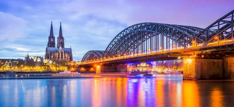 Renowned Cologne Cathedral and Hohenzollern Bridge at night