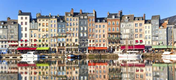 Sunny View of Colourful Houses Along Honfleur's Harbour | Riviera Travel