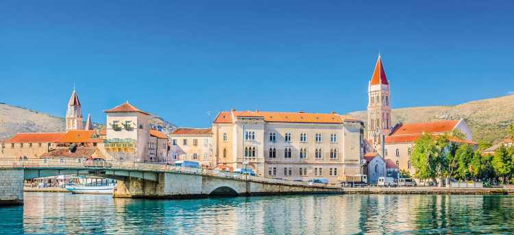 Pastel coloured buildings and stone bridge | Trogir waterfront | Croatia | Riviera Travel | yacht cruise