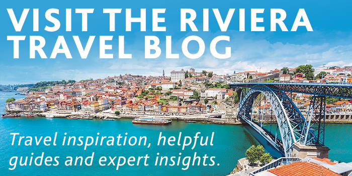 Visit the Riviera Travel blog - Porto bridge over turquoise river leading to city with terracotta rooftops