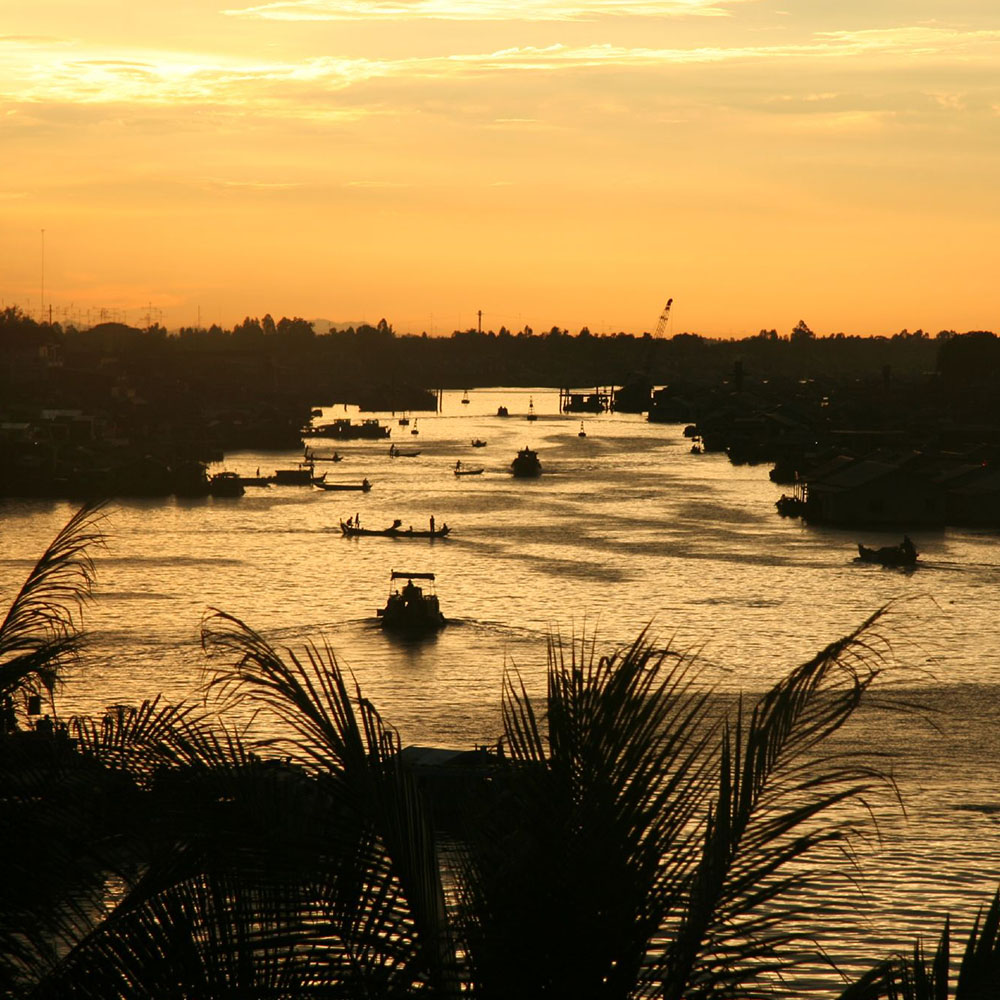 Boats on the Mekong at sunset